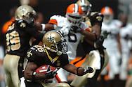 MORNING JOURNAL/DAVID RICHARD.Reggie Bush looks for running room against the Browns.