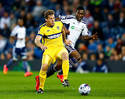 Johnny Mullins of Oxford United is challenged by Brown Ideye of West Brom - Photo mandatory by-line: Rogan Thomson/JMP - 07966 386802 - 26/08/2014 - SPORT - FOOTBALL - The Hawthorns, West Bromwich - West Bromwich Albion v Oxford United - Capital One Cup Round 2.