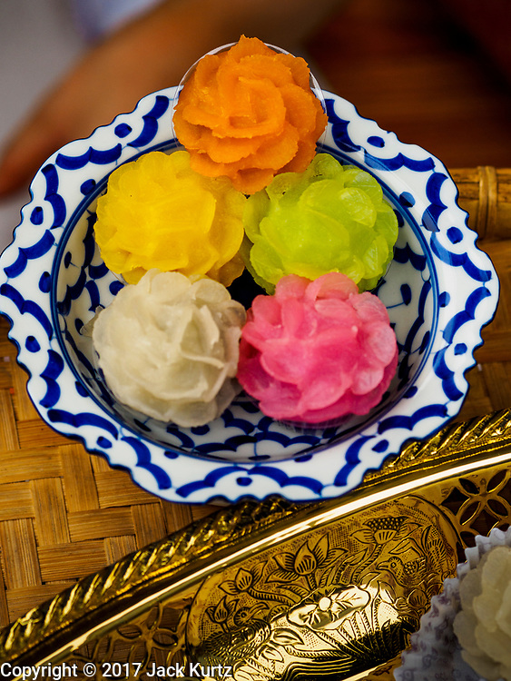 "08 APRIL 2017 - BANGKOK, THAILAND: Samples of traditional Thai desserts at the ""Amazing Songkran"" festival in Benchasiri Park in Bangkok. The festival was sponsored by the Tourism Authority of Thailand to highlight the cultural aspects of Songkran. Songkran is celebrated in Thailand as the traditional New Year's Day from 13 to 16 April. Songkran is in the hottest time of the year in Thailand, at the end of the dry season and provides an excuse for people to cool off in friendly water fights that take place throughout the country. Songkran has been a national holiday since 1940, when Thailand moved the first day of the year to January 1. Songkran 2017 is expected to be more subdued than Songkran usually is because Thais are still mourning the October 2016 death of revered King Bhumibol Adulyadej.       PHOTO BY JACK KURTZ"