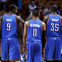 16 March 2011: Oklahoma City Thunder power forward Serge Ibaka (9), Oklahoma City Thunder point guard Russell Westbrook (0) and Oklahoma City Thunder small forward Kevin Durant (35) are seen during the Oklahoma City Thunder 96-85 victory over the Miami Heat at the AmericanAirlines Arena, Miami, Florida, USA.