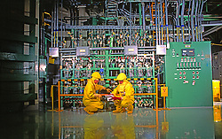 Nuclear Power Plant Engineers wearing protective clothing