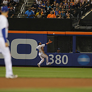 Juan Lagares, New York Mets, can't make the catch which resulted in a Jose Bautista, Toronto Blue Jays, triple during the New York Mets Vs Toronto Blue Jays MLB regular season baseball game at Citi Field, Queens, New York. USA. 16th June 2015. Photo Tim Clayton