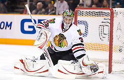 January 28, 2010; San Jose, CA, USA; Chicago Blackhawks goalie Cristobal Huet (39) makes a glove save against the San Jose Sharks during the first period at HP Pavilion. Chicago defeated San Jose 4-3 in overtime. Mandatory Credit: Jason O. Watson / US PRESSWIRE
