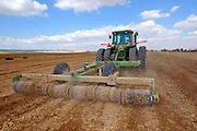 Israel, Negev Desert, Tractor harrowing a field