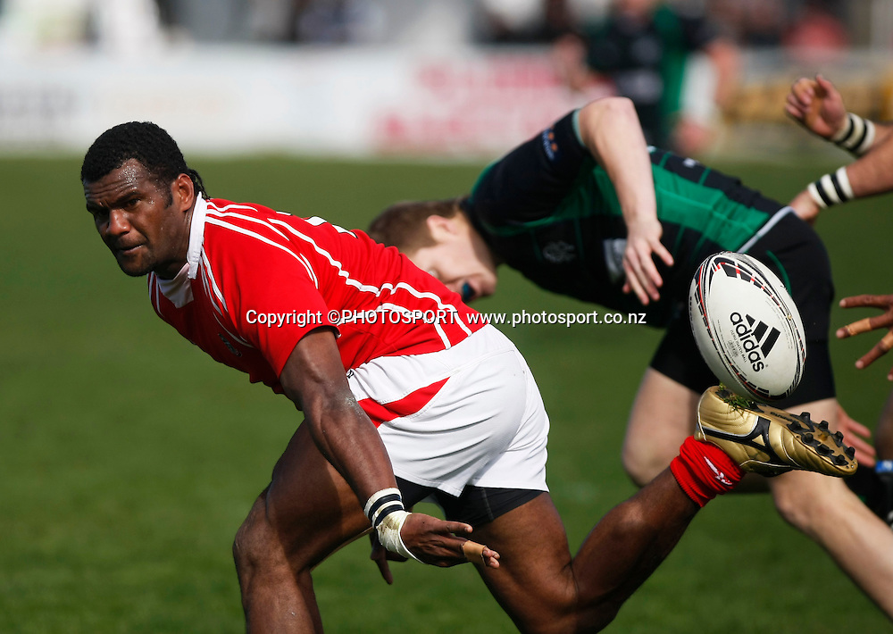 Paulo Tikomainaivalu does a flicks pass for Poverty Bay during the Heartland Championship Lochore Cup Final between, South Canterbury v Poverty Bay at Alpine Energy Stadium, Timaru, South Canterbury. Saturday 8 October 2011. Photo : Joseph Johnson/photosport.co.nz