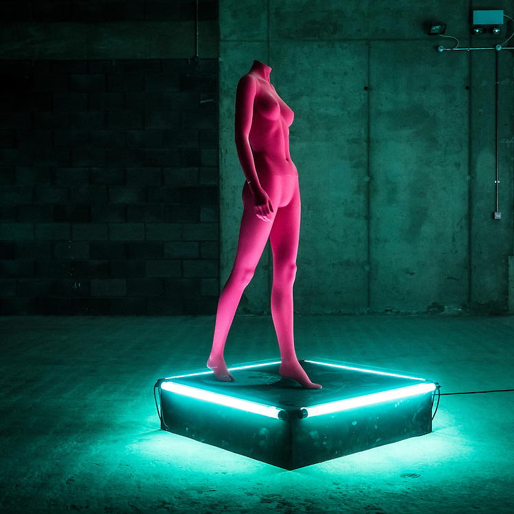 A hot pink mannequin stands in the space of the empty ground floor of 2 Pancras Square, on Kings Boulevard in Kings Cross, London.