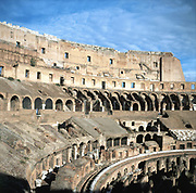 Colosseum, Rome, showing side elevation and upper tiers. Ancient Roman amphitheatre. Photograph.
