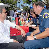 Santa Monica Fire Captain M. Bridges checks Santa Monica Mayor Richard Bloom's blood pressure during the Santa Monica Chamber of Commerce's 26th Annual Health and Fitness Festival at the Third Street Promenade on Saturday, July 30, 2011. Mayor Blooms results were great with a value of  115 over 59.