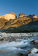 At early sunrise under the Horns, a stream flows into Lago (Lake) Nordenskjold, at Albergue Los Cuernos, a refuge (hut) in Torres del Paine National Park, Chile, Patagonia, South America. The panorama was stitched from 4 overlapping images.