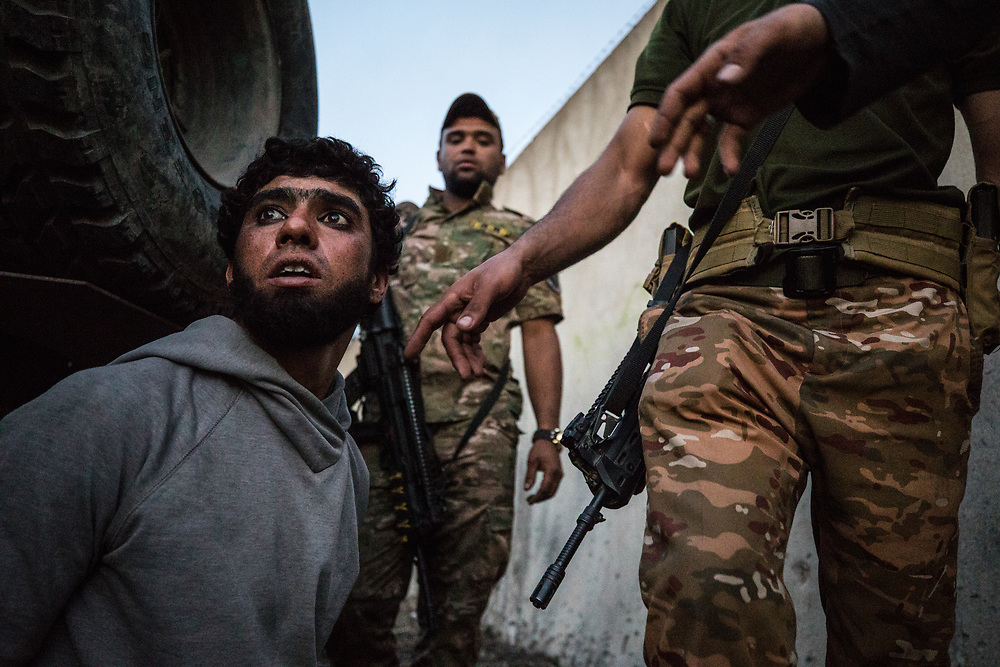 ISIS fighter Hassan Falah is captured by Iraqi forces in the Al Thawra neighborhood. West Mosul, Iraq. Apr. 19, 2017. (Photo by Gabriel Romero ©2017)