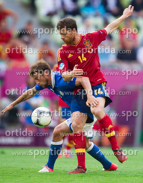 Claudio Marchisio of Italy vs Xabi Alonso of Spain during the UEFA EURO 2012 group C match between Spain and Italy at The Arena Gdansk on June 10, 2012 in Gdansk, Poland.  (Photo by Vid Ponikvar / Sportida.com)
