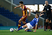 Danny Devine of Bradford City is tackled by Louis Reed of Chesterfield during the EFL Trophy match between Chesterfield and Bradford City at the b2net stadium, Chesterfield, England on 29 August 2017. Photo by Paul Thompson.