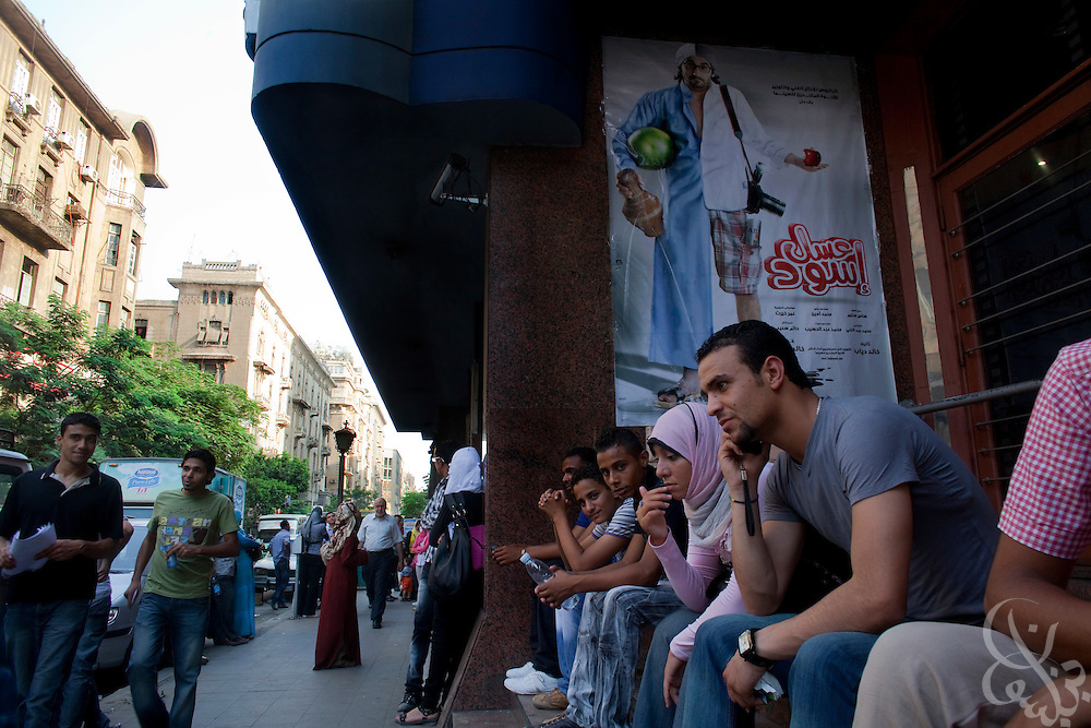 "Egyptian movie fans wait to enter a theater June 15, 2010 to see the recently released film by Egyptian comedy star Ahmed Helmy entitled ""Asal Eswed"" (literally translated, ""Black Honey"") in downtown Cairo, Egypt. The film is a social satire that tackles  issues of national identity. (Photo by Scott Nelson for the National)"