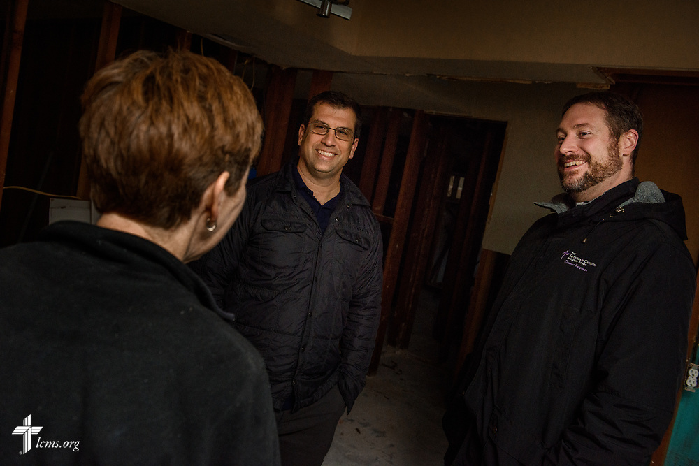 The Rev. Ross Johnson, director of LCMS Disaster Response, and the Rev. Michael Meyer, manager of LCMS Disaster Response, greet Sue Husar, a volunteer from Saint Paul Lutheran Church, Mount Prospect, Ill., on Wednesday, Feb. 7, 2018, at a home in Port Arthur, Texas.   LCMS Communications/Erik M. Lunsford