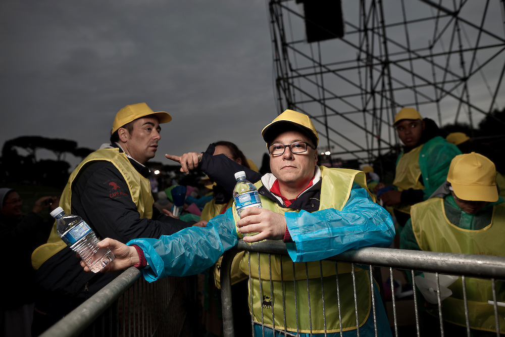 A member from an association of charity distributes water. On 1 May 2011, six years and one month after his death, Pope John Paul II was beatified by his successor Benedict XVI..It is estimated that over one half million people have taken part in the ceremony which was held in St. Peter's Square, the largest crowd in Rome since his funeral. .This is considered the fastest beatification in Church history, the Vatican will have to attribute another miracle to John Paul's intercession after the beatification, only in this case he will be declared a saint.