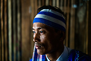 U Saw Zar Li, an ethnic Karen village health volunteer, in portrait in Taung Kalay village, Kayin State, Myanmar.
