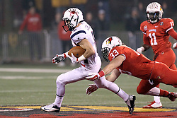 11 December 2015:  Pat Meehan lunges for the legs of Porter Abell. NCAA FCS Quarter Final Football Playoff game between Richmond Spiders and Illinois State Redbirds at Hancock Stadium in Normal IL (Photo by Alan Look)