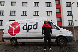 © Licensed to London News Pictures . 20/11/2015 . Manchester , UK . Internet prankster WAYNE PHILLIPS in Salford today (20th November 2015) . Phillips , who is currently working as a self-employed DPD delivery driver , became famous after pranking TV adverts and performing gags and stunts on YouTube and Vine , including a spoof of the Money Supermarket advert which he acted out in high heels and short shorts , near to his home , at Wythenshawe Precinct , in South Manchester and which went viral . Photo credit : Joel Goodman/LNP