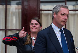 © Licensed to London News Pictures. 15/05/2015.  UKIP leader NIGEL FARAGE being given a thumbs up by a passer by after leaving Hertford Street Members Club in Mayfair, London after a meeting with UKIP party donors on May 15, 2015. Farage has been critiqued by members of the UKIP party after a u-turn on his decision to stand down as leader. Photo credit: Ben Cawthra/LNP