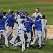 Closing pitcher Wade Davis is mobbed by teammates as Kansas City Royals win the World Series and empty the dugout during the New York Mets Vs Kansas City Royals, Game 5 of the MLB World Series at Citi Field, Queens, New York. USA. 1st November 2015. Photo Tim Clayton