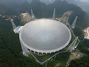 "QIANNAN, CHINA - SEPTEMBER 17: <br /> <br /> Aerial view of a dish-like radio telescope at Pingtang County on September 17, 2016 in Qiannan Buyei and Miao Autonomous Prefecture, Guizhou Province of China. After five years construction, ""Five hundred meter Aperture Spherical Telescope (FAST) will be put into use on September 25. The local public security bureau has intensified security since September 16 in the core zone and around the radio telescope to ensure the radio telescope\'s completion goes well. <br /> ©Exclusivepix Media"
