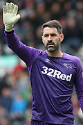 Derby County goalkeeper Scott Carson waves during the EFL Sky Bet Championship match between Derby County and Sheffield Wednesday at the Pride Park, Derby, England on 9 March 2019.
