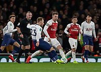 Football - 2018 / 2019 EFL Carabao Cup (League Cup) - Quarter-Final: Arsenal vs. Tottenham Hotspur<br /> <br /> Christian Eriksen (Tottenham FC)  with a long drive at the Arsenal goal at The Emirates.<br /> <br /> COLORSPORT/DANIEL BEARHAM