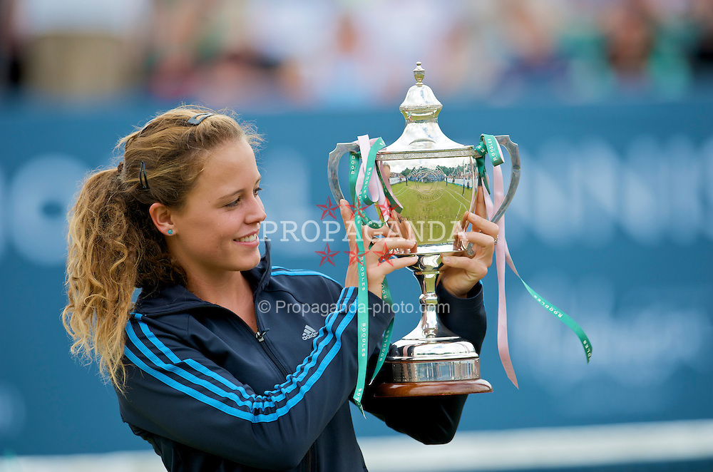 LIVERPOOL, ENGLAND - Saturday, June 20, 2009: 2009 Tradition ICAP Liverpool International Tennis Tournament Women's Champion Michelle Larcher De Brito (POR) holds aloft the Boodles & Dunthorpe Trophy after her 6-4, 2-6, 10-4 STB victory over Laura Robson (GBR) at Calderstones Park. (Pic by David Rawcliffe/Propaganda)