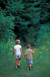 A brother and sister enjoy a trail near Meadow Pond on land recently protected by TPL.  Stephenson's Way.  Groveland, MA