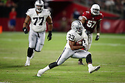 Oakland Raiders running back DeAndre Washington (33) high steps as he runs for a gain of 25 yards and a first down at the Arizona Cardinals 35 yard line in the second quarter during the 2016 NFL preseason football game against the Arizona Cardinals on Friday, Aug. 12, 2016 in Glendale, Ariz. The Raiders won the game 31-10. (©Paul Anthony Spinelli)