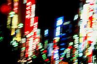 Neon lights blurred in Shinjuku, Tokyo, Japan at night