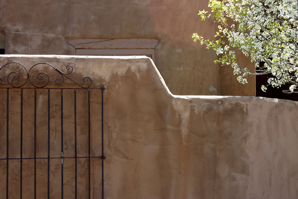 Adobe wall and black metal gate, Santa Fe New Mexico