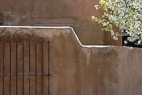 Adobe wall and black metal gate, Santa Fe New Mexico