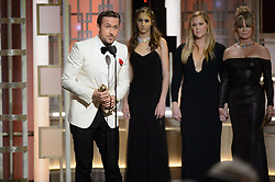 """Jan 8, 2017 - Beverly Hills, California, U.S - RYAN GOSLING accepts the Golden Globe Award for BEST PERFORMANCE BY AN ACTOR IN A MOTION PICTURE – COMEDY OR MUSICAL for his role in """"La La Land"""" at the 74th Annual Golden Globe Awards at the Beverly Hilton in Beverly Hills, CA on Sunday, January 8, 2017. (Credit Image: ? HFPA/ZUMAPRESS.com)"""