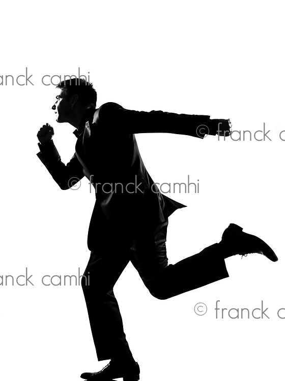 silhouette caucasian business man  running profile   full length on studio isolated white background