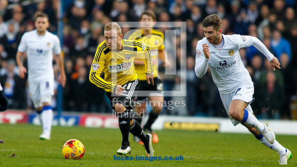Alex Pritchard of Brentford and Luke Murphy of Leeds United during the Sky Bet Championship match between Leeds United and Brentford at Elland Road, Leeds<br /> Picture by Mark D Fuller/Focus Images Ltd +44 7774 216216<br /> 07/02/2015