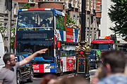 A tour bus with The Original Tour drives past crowds on the Embankment, on 7th July 2017, in Westminster, central London.