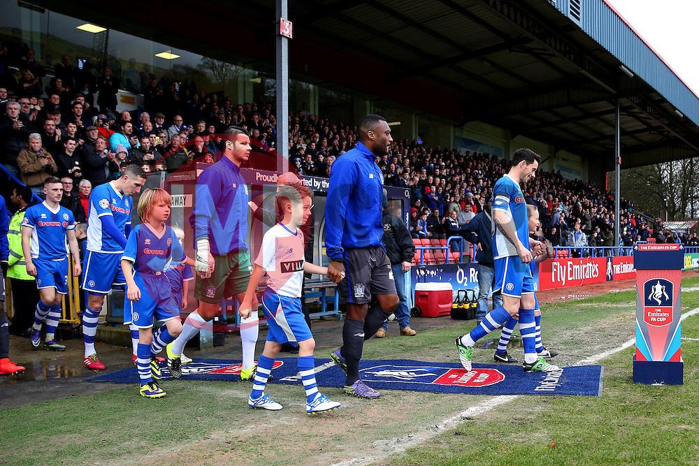 Teams walk out ahead of kick off - Mandatory byline: Matt McNulty/JMP - 06/12/2015 - Football - Spotland Stadium - Rochdale, England - Rochdale v Bury - FA Cup