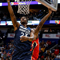 Nov 29, 2017; New Orleans, LA, USA; Minnesota Timberwolves guard Jimmy Butler (23) shoots past New Orleans Pelicans center DeMarcus Cousins (0) during the first quarter of a game at the Smoothie King Center. Mandatory Credit: Derick E. Hingle-USA TODAY Sports