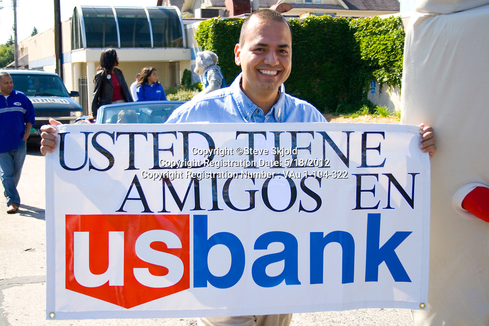 "Banker holding banner ""You have friends at US Bank"" in the parade. Mexican Independence Day Minneapolis Minnesota MN USA"