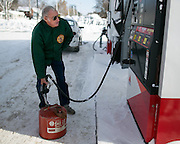 Don Richardson fills a gas can in Batavia, New York, USA on Wednesday, November 19, 2014. Up to six feet of snow fell on the region Tuesday, stranding dozens of motorists on roadways and causing at least six deaths.