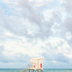 Lifeguard tower five in Casino Beach in Pensacola Beach Florida. Pensacola Beach is on Santa Rosa Island in the Emerald Coast area of the Southeastern United States of America. Photo is vertical and high resolution. Copyright ⓒ 2018 Paul Velgos with All Rights Reserved.