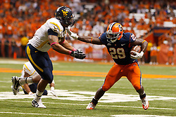 Oct 21, 2011; Syracuse NY, USA;  Syracuse Orange running back Antwon Bailey (29) stiff arms West Virginia Mountaineers defensive lineman Julian Miller (97) during the third quarter at the Carrier Dome.  Syracuse defeated West Virginia 49-23. Mandatory Credit: Jason O. Watson-US PRESSWIRE