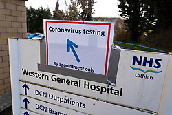 Edinburgh, Scotland, UK. 12 March, 2020. Sign towards Coronavirus testing bay at NHS Lothian Western General Hospital in Edinburgh today. Iain Masterton/Alamy Live News