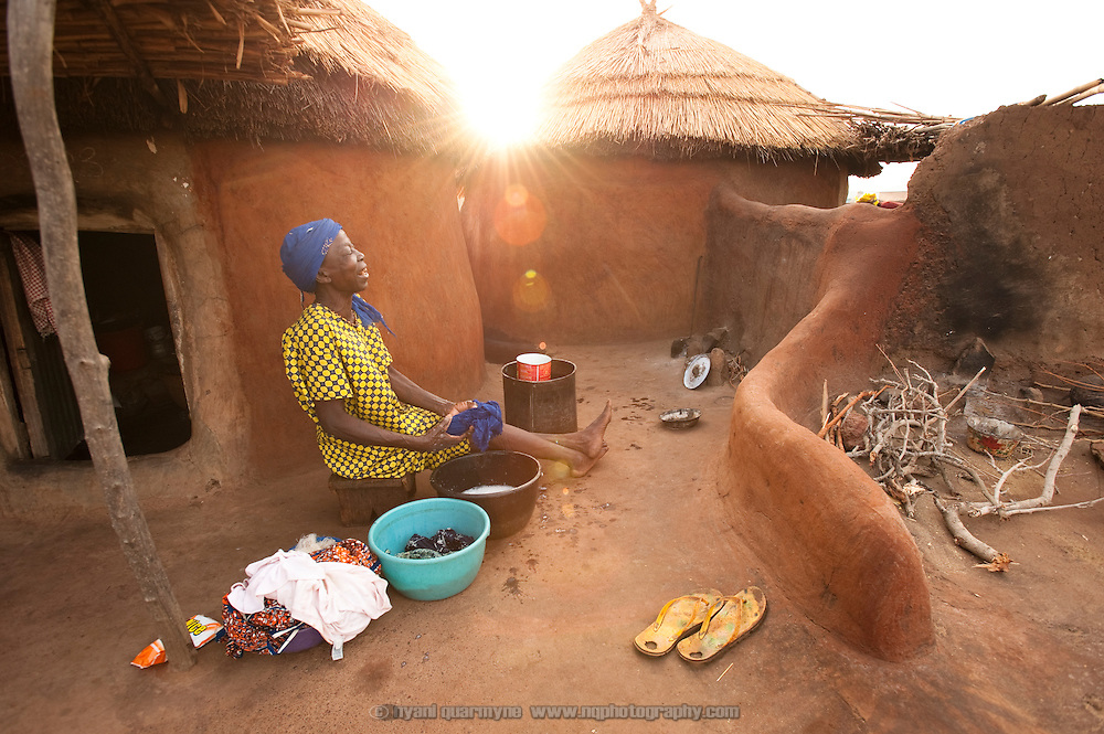 A resident of the Gambaga camp for alleged witches doing her laundry.
