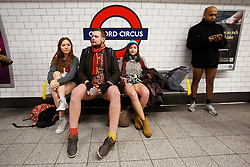 © licensed to London News Pictures. London, UK 12/01/2014. Over 150 people take part in the 5th annual 'No Trousers Tube Ride' on the London Underground on Sunday, 12 January, 2014. Participants travel on the tube without trousers as part of the event to surprise other passengers. The tradition started by a collective called 'Improv Everywhere' in New York 12 years ago. Photo credit: Tolga Akmen/LNP