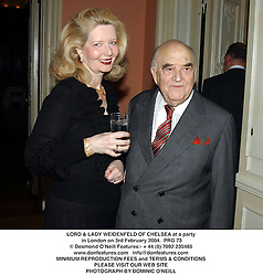 LORD & LADY WEIDENFELD OF CHELSEA at a party in London on 3rd February 2004.PRG 73