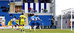 COLCHESTER, ENGLAND - Saturday, February 23, 2013: Tranmere Rovers' Ash Taylor scores the third goal past Colchester United's goalkeeper Sam Walker during the Football League One match at the Colchester Community Stadium. (Pic by Vegard Grott/Propaganda)