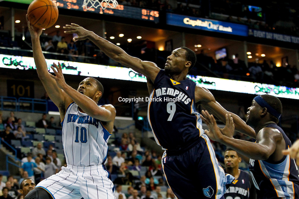 December 21, 2011; New Orleans, LA, USA; New Orleans Hornets shooting guard Eric Gordon (10) drives and shoots past Memphis Grizzlies shooting guard Tony Allen (9) and power forward Zach Randolph (50) during the second half of a preseason game at the New Orleans Arena. The Hornets defeated the Grizzlies 95-80.  Mandatory Credit: Derick E. Hingle-US PRESSWIRE