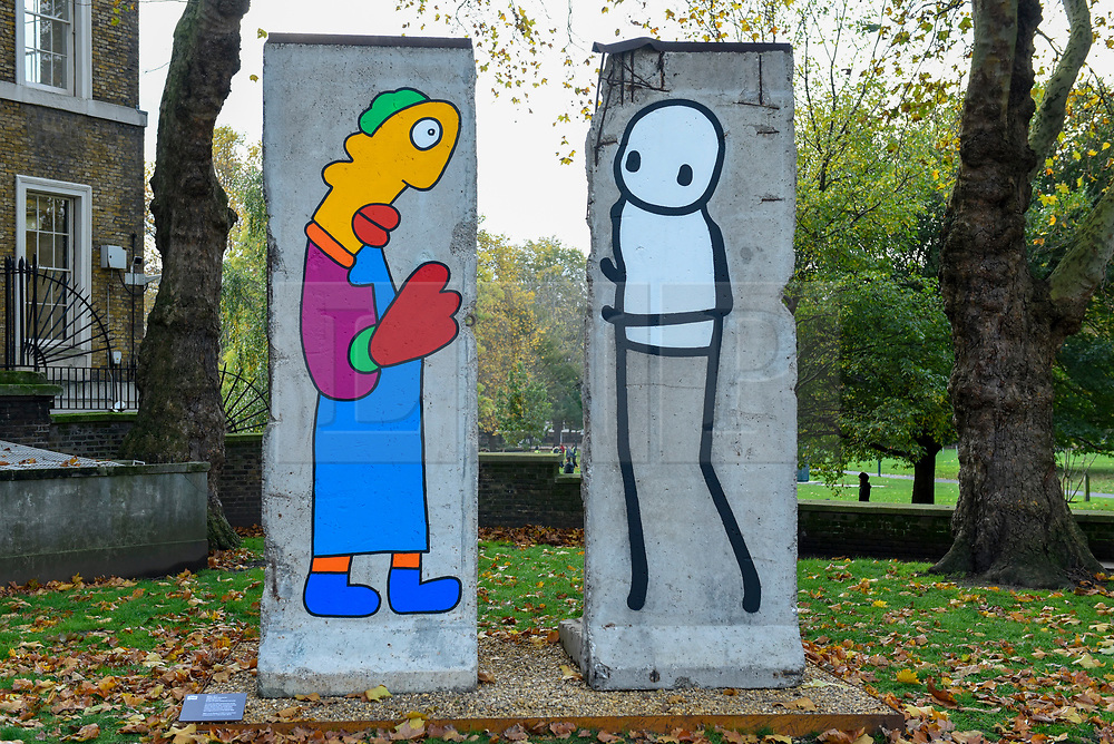 © Licensed to London News Pictures. 05/11/2019. LONDON, UK.  Unveiling of new work by artists Theirry Noir (L) and STIK (R) on original Berlin Wall sections to mark 30 years since the fall of the Berlin Wall.  Located outside the Imperial War Museum, the new works reflect the symbolic connections between the Berlin Wall and street art and the fall of the wall on 9 November 1989.  These new works are on display until 1 December.  Photo credit: Stephen Chung/LNP